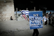JERUSALEM: A supporter of Israel holds a poster next to Jaffa Gate in Jerusalem's Old City on March 09, 2010.