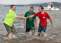 Sheriff Craig Wiggin, Salvation Army Committe member John Egan and Mayor Michael Seymour enjoy their dip into Lake Winnipesaukee for the 6th annual Turkey Plunge on Saturday afternoon.  (Karen Bobotas/for the Laconia Daily Sun)