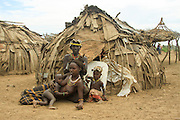 Africa, Ethiopia, Omo Valley, Daasanach family in front of hut