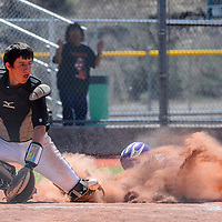 050215  Adron Gardner/Independent<br /> <br /> Gallup Bengal Kevin Stewart (5) lines up a catch as  Miyamura Patriot William McKinley (18) slides safe to home plate at Ford Canyon Park in Gallup Saturday.