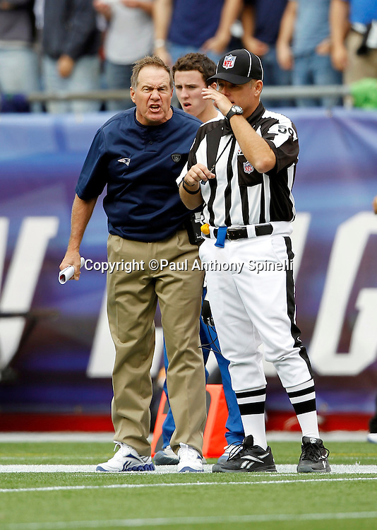 New England Patriots Head Coach Bill Belichick yells at NFL Line Judge Rusty Baynes (59) during the NFL regular season week 3 football game against the Buffalo Bills on September 26, 2010 in Foxborough, Massachusetts. The Patriots won the game 38-30. (©Paul Anthony Spinelli)