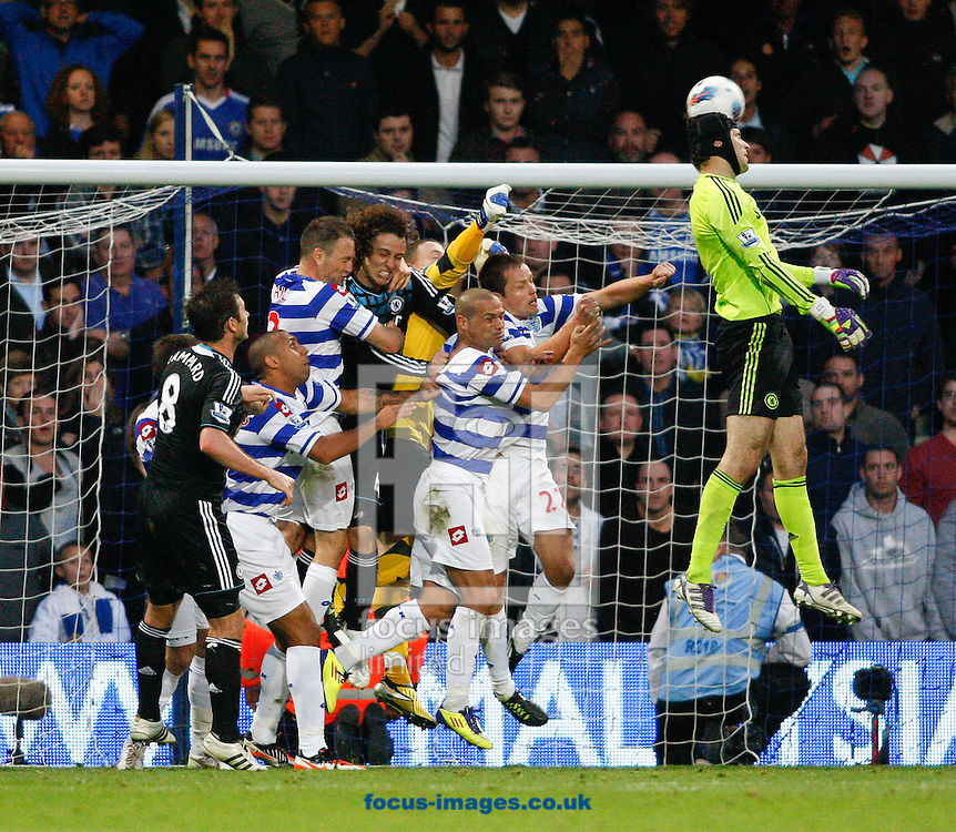 Picture by Andrew Tobin/Focus Images Ltd. 07710 761829. 23/10/11. Petr Cech (1) of Chelsea heads the ball as Chelsea desperately try to equalise during the Barclays Premier League match between QPR and Chelsea at Loftus Road, London.