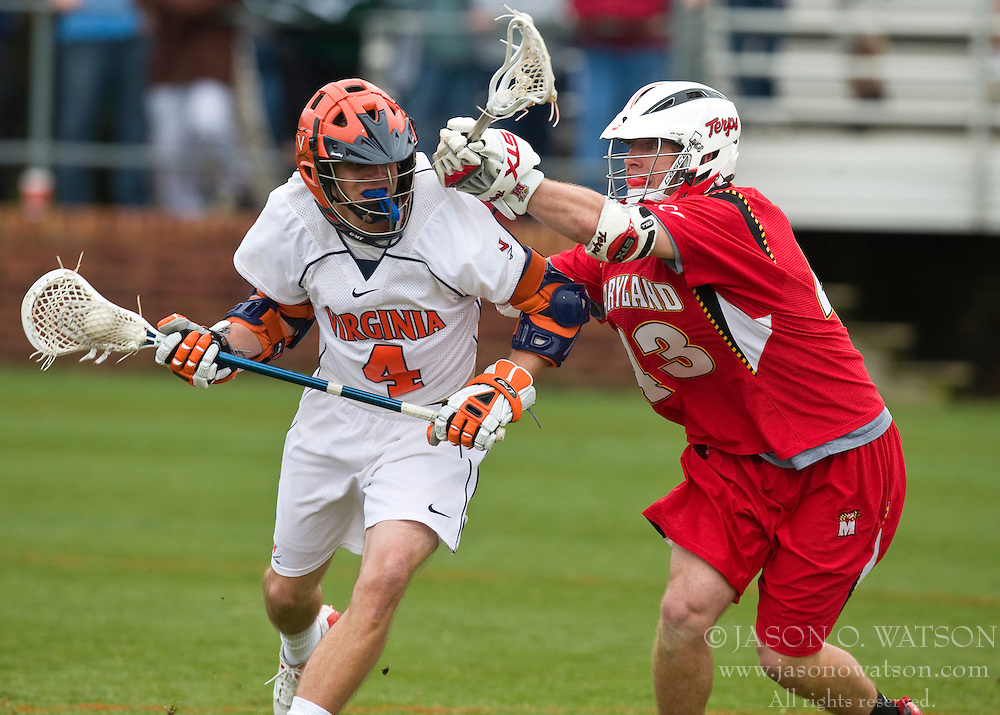 Virginia Cavaliers A Gavin Gill (4) is checked by Maryland Terrapins Midfield Jake Bernhardt (43).  The #9 ranked Maryland Terrapins fell to the #1 ranked Virginia Cavaliers 10 in 7 overtimes in Men's NCAA Lacrosse at Klockner Stadium on the Grounds of the University of Virginia in Charlottesville, VA on March 28, 2009.