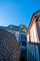 Looking up at the Abbey of Mont-Saint-Michel from the narrow streets of the village below.