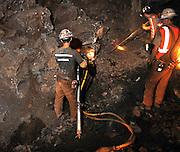 Mining engineering students drill holes for blasting powder during training at the San Xavier Mining Laboratory Training Center, University of Arizona, Tucson, Arizona, USA.