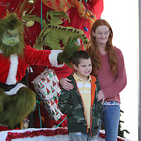 Libby Ezell | BUY AT PHOTOS.DJOURNAL.COM<br /> The Grinch gives bunny ears to Micha Brown, 7, while he takes a photo with Dow Presley from Okolona