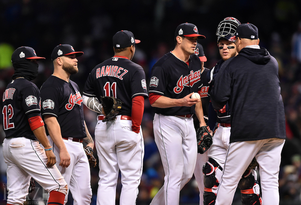 Oct 26, 2016; Cleveland, OH, USA; Cleveland Indians relief pitcher Jeff Manship (middle) is relieved by manager Terry Francona (right) in the 7th inning in game two of the 2016 World Series at Progressive Field. Mandatory Credit: Ken Blaze-USA TODAY Sports