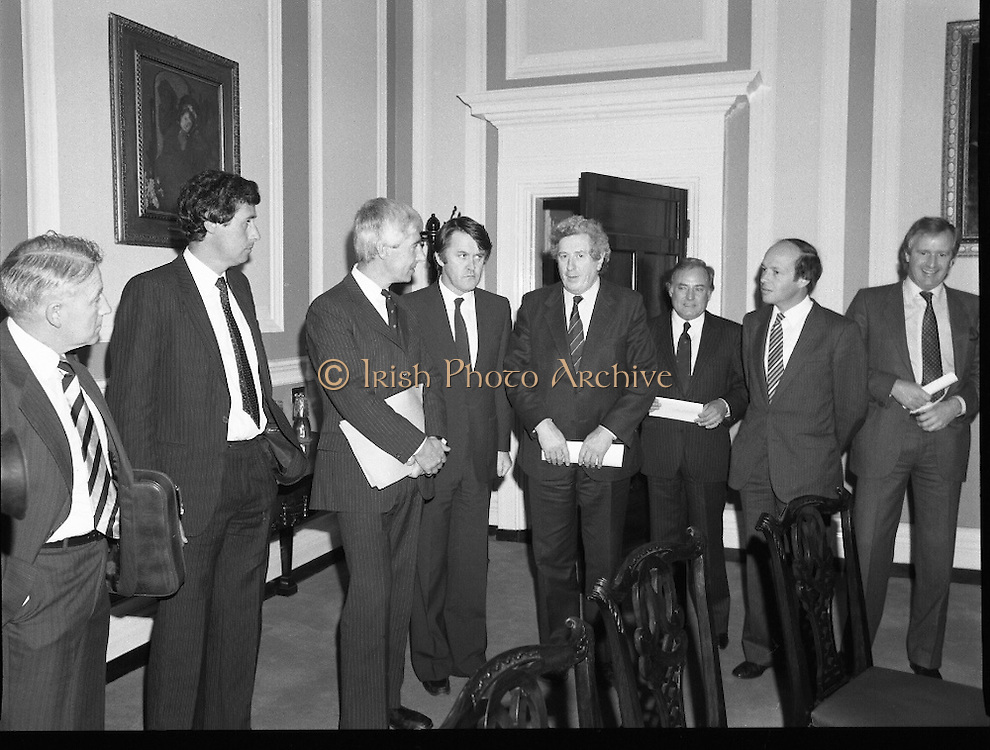 Taoiseach Meets With Unionist Representatives. (N96)..1981..08.10.1981..10.08.1981..8th October 1981..At Government Buildings, An Taoiseach, Dr Garret Fitzgerald, met with representatives of the Northern Ireland Unionist Community. They hoped to discuss on-going problems which were bedeviling the communities in the North of Ireland...Image shows An Taoiseach, Dr Garret Fitzgerald and An Tanaiste, Mr Michael O'Leary  welcoming the Northern Unionists to Leinster House, Dublin..Included in the image are Mr Herbert McCracken,Businessman, Bryan Somers, Businessman, Mr Bob McCartney, Q.C., Mr Michael O'Leary TD, Dr Garret Fitzgerald TD,Gordon Smyth,Businessmen. Mr Peter Smith Q.C., and Mr Sean Hall, Businessman.