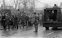 Participants in a banned Civil Rights Association march down the Falls Road, Belfast, N Ireland, are obliged to fllter through an army barrier across the road, 2nd January 1972. 197201020008<br />
