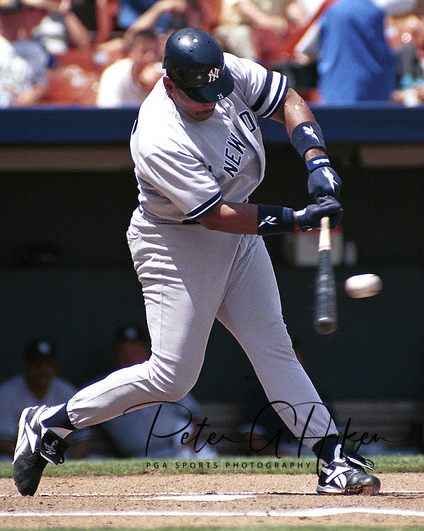 New York Yankee Cecil Fielder drives through the ball against the Kansas City Royals at Kauffman Stadium in Kansas City, Missouri on May 4, 1997.