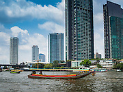 01 APRIL 2014 - BANGKOK, THAILAND:  A long tailed boat on the Chao Phraya River in Bangkok. Long tailed boats are traditional Thai river boats used to haul freight and passengers. In Bangkok, tourists use the boats but upcountry they're still used by Thais.       PHOTO BY JACK KURTZ