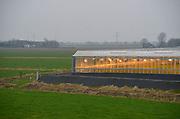 Nederland, Oosterhout, 7-1-2013Een kas bij donker en grijs weer, omringd door weiland in de Betuwe.Foto: Flip Franssen/Hollandse Hoogte