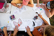 Bracken Cave Preserve, San Antonio, Texas:  Children learn about Mexican Free-tailed bats, and make 'bat masks' while waiting for the bats to emerge at Bracken Cave.