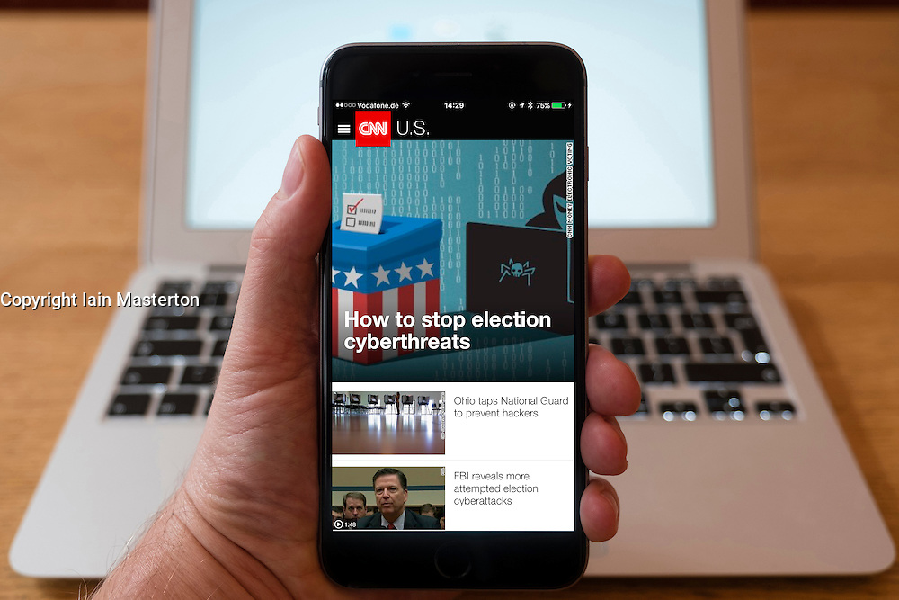 Using iPhone smartphone to display headlines on homepage of CNN news app