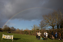 Harefield, UK. 17 January, 2020. A rainbow appears as activists from Stop HS2 and Extinction Rebellion begin a three-day 'Stand for the Trees' protest in the Colne Valley. The event has been timed to coincide with tree felling work by HS2 adjacent to the site of Stop HS2's Colne Valley wildlife protection camp. Bailiffs acting for HS2 have been evicting Stop HS2 activists from the camp for the past week and a half. 108 ancient woodlands are set to be destroyed by the high-speed rail link.