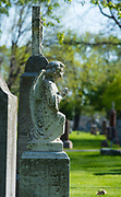 An angel headstone is covered with lichens at Allouez Catholic Cemetery in Allouez, Wis. May 28 is Memorial Day. (Sam Lucero | The Compass)