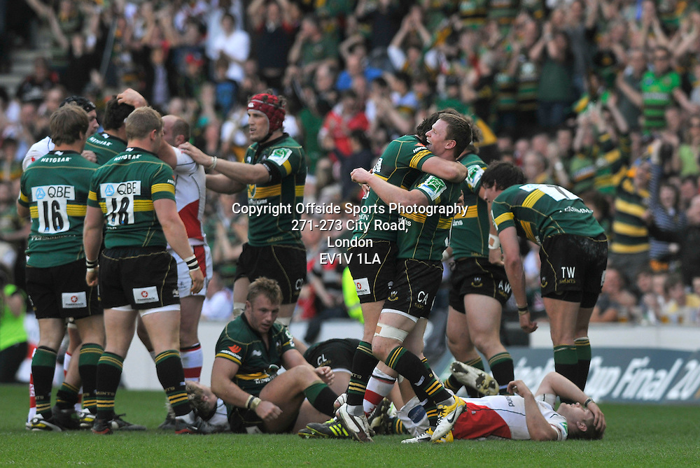 10/04/2011 - Heineken Cup Quarer Final Rugby - Northampton Saints vs Ulster - Northampton players Chris Ashton and Lee Dickson celebrate the teams win at the final whistle. - Photo: Charlie Crowhurst / Offside.