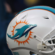 A Miami Dolphins helmet on the sideline during the New York Jets Vs Miami Dolphins  NFL American Football game at MetLife Stadium, East Rutherford, NJ, USA. 1st December 2013. Photo Tim Clayton