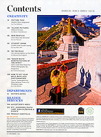 Shutterbug Magazine, November 2014 issue, photo by Blaine Harrington III of a Chinese couple praying, with Potala Palace in background, Lhasa, Tibet, China.