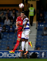 Lloyd Jones of Swindon Town and Yeni Atito Ngbakoto of Queens Park Rangers challenge for a header - Mandatory by-line: Robbie Stephenson/JMP - 10/08/2016 - FOOTBALL - Loftus Road - London, England - Queens Park Rangers v Swindon Town - EFL League Cup