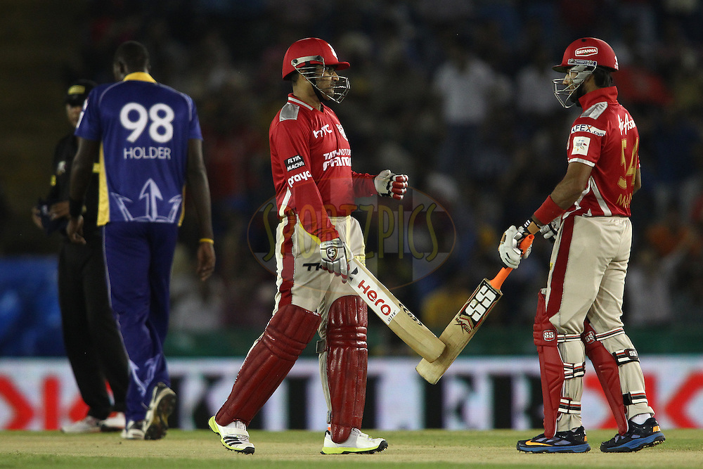 Virender Sehwag of the Kings XI Punjab and Manan Vohra of the Kings XI Punjab celebrate a six during match 5 of the Oppo Champions League Twenty20 between the Kings XI Punjab and the Barbados Tridents held at the Punjab Cricket Association Stadium, Mohali, India on the 20th September 2014<br /> <br /> Photo by:  Shaun Roy / Sportzpics/ CLT20<br /> <br /> <br /> Image use is subject to the terms and conditions as laid out by the BCCI/ CLT20.  The terms and conditions can be downloaded here:<br /> <br /> http://sportzpics.photoshelter.com/gallery/CLT20-Image-Terms-and-Conditions-2014/G0000IfNJn535VPU/C0000QhhKadWcjYs