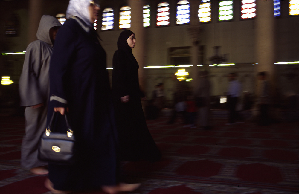 Syria, a young girl in the inside of the Umayyad mosque in Damascus.