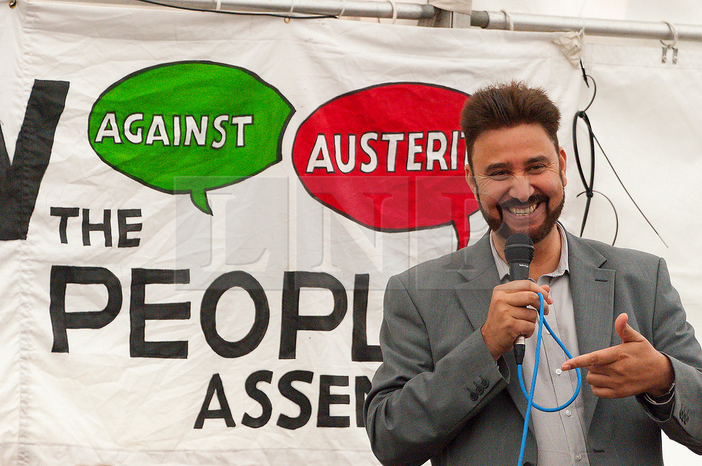 30/09/2017. Manchester, UK. Afzal Khan MP, speaks at the People's Event marquee in Piccadilly Gardens, Manchester, during a Stop The War event on the eve of The Conservative Party Conference. Pro-peace, anti-austerity, anti-war protests, including rallies, public meetings, comedy, music, & culture, take place during the four days of the Conservative Party Conference in Manchester, UK. 1st - 4th Oct 2017. The protest festival has been organised by The People's Assembly. Photo credit: Graham M. Lawrence/LNP