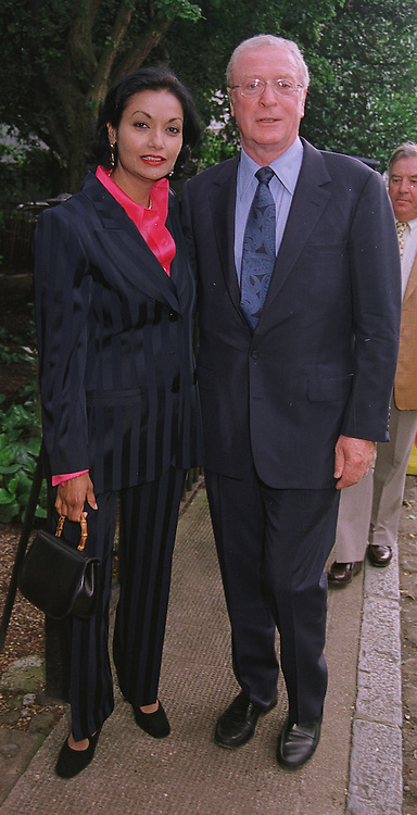 MR & MRS MICHAEL CAINE he is the actor, at a party in London on 30th June 1999.MTY 69