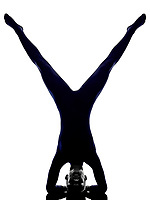 woman exercising vrschikasana scorpion pose yoga silhouette shadow white background
