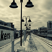 Snow covered tracks and platform of commuter rail station at Yonkers