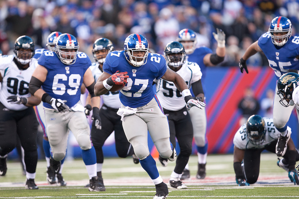 EAST RUTHERFORD, NJ - NOVEMBER 28: New York Giants running back Brandon Jacobs #27 rushes against the Jacksonville Jaguars on November 28, 2010 at the New Meadowlands Stadium in East Rutherford, New Jersey.The Giants defeated the Jaguars 24 to 20. (Photo by Rob Tringali) *** Local Caption *** Brandon Jacobs
