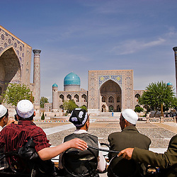 Group of locals in front of the Registan, Samarcand, Uzbekistan, Asia
