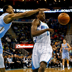 Mar 25, 2013; New Orleans, LA, USA; Denver Nuggets shooting guard Andre Iguodala (9) knocks the ball away from New Orleans Hornets small forward Al-Farouq Aminu (0) during the first quarter of a game at the New Orleans Arena. Mandatory Credit: Derick E. Hingle-USA TODAY Sports