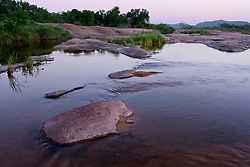 Stock photo of the pink granite rocks in and along the Llano River in the Texas Hill Country