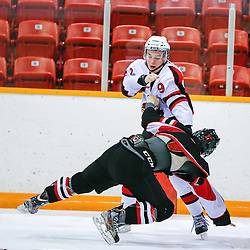 PICKERING, ON - Dec 15 : Ontario Junior Hockey League Game Action between the Pickering Panthers Hockey Club, and Stouffville Spirit Hockey Club, Cam Palmer #9 of the Pickering Panthers Hockey Club fights with Joseph Deveny #27 of the Stouffville Spirit Hockey Club<br /> (Photo by Keith White / OJHL Images)