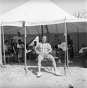 Security sitting in a tent, Glastonbury, Somerset, 1989