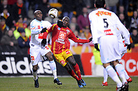FOOTBALL - FRENCH CUP 2009/2010 - 1/16 FINAL - 10/02/2010 - RC LENS v OLYMPIQUE MARSEILLE - PHOTO JEAN MARIE HERVIO / DPPI - KANGA AKALE (RCL) / STEPHANE MBIA (OM)