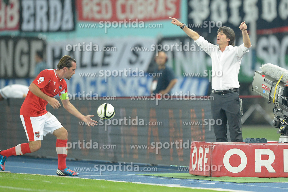 11.09.2012, Ernst Happel Stadion, Wien, AUT, FIFA WM Qualifikation, Oesterreich vs Deutschland, im Bild dirigiert Joachim Löw (GER, Coach), links holt Christian Fuchs (AUT, #5) den Ball // during FIFA World Cup Qualifier Match between Austria and Germany at the Ernst Happel Stadion, Vienna, Austria on 2012/09/11. EXPA Pictures © 2012, PhotoCredit: EXPA/ Gerald Dvorak
