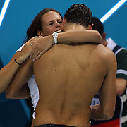 Florent Manaudou, France, winning the Gold Medal in the 50m Freestyle Final is embraced by his  sister Laure at the Aquatic Centre at Olympic Park,  during the London 2012 Olympic games. London, UK. 3rd August 2012. Photo Tim Clayton