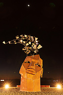 The Flybrary at Night Under the Moon<br /> by: Christina Sporrong<br /> from: Taos, NM<br /> year: 2019<br /> <br /> The Flybrary is an extraordinary library within an enormous human head, partially cut open at the top allowing a flock of illuminated birds to emerge. Within the head are several levels of catwalks to climb and nooks and crannies to sit in and enjoy the selection of books. The eyes and mouth are portholes to the outside world. Up above, the open ceiling holds a large chandelier radiating soft light within. It's a dreamy, transformative space providing an intimate and surreal refuge for contemplation, written wisdom and freedom of thought.<br /> <br /> URL: https://spitfireworks.blogspot.com/<br /> Contact: spitfire4rg@gmail.com<br /> <br /> https://burningman.org/event/brc/2019-art-installations/?yyyy=&artType=H#a2I0V000001AW03UAG<br /> <br /> <br /> The Flybrary, The Flybrary at night, Christina Sporrong, Christina Sporrong
