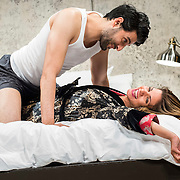 """July 10, 2015 - New York, NY : Karan Oberoi, top, and Alia Attallah perform in a dress rehearsal for Portland Center Stage<br /> and A Contemporary Theatre (ACT)'s presentation of Yussef El Guindi's """"Threesome"""" at 59E59 on Friday evening. CREDIT: Karsten Moran for The New York Times"""