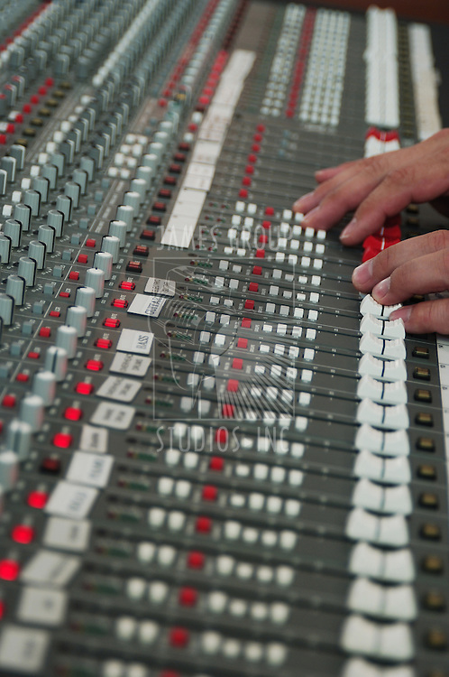 audio mixing board with hands