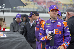 June 10, 2018 - Brooklyn, Michigan, United States of America - Denny Hamlin (11) waits for the start of the FireKeepers Casino 400 during a weather delay at Michigan International Speedway in Brooklyn, Michigan. (Credit Image: © Stephen A. Arce/ASP via ZUMA Wire)