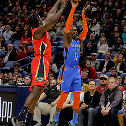 Dec 12, 2018; New Orleans, LA, USA; Oklahoma City Thunder guard Dennis Schroder (17) shoots over New Orleans Pelicans guard Jrue Holiday (11) during the second quarter at the Smoothie King Center. Mandatory Credit: Derick E. Hingle-USA TODAY Sports