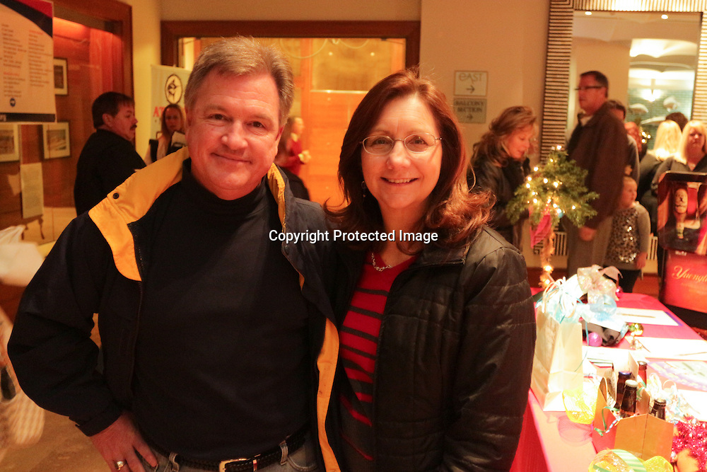 Don James, left, and Cindy Isenhour pose for a photo Friday November 28, 2014 during the Atlantic Marine Holiday Flotilla Launch Party. (Jason A. Frizzelle)