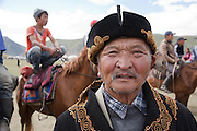 Man at a traditional Kyrgyz horse games festival. Bosogo jailoo, Naryn province, Kyrgyzstan.