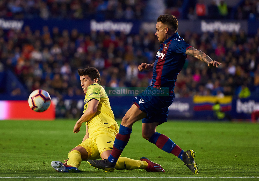 March 10, 2019 - Valencia, U.S. - VALENCIA, SPAIN - MARCH 10: Santiago Caseres, midfielder of Villarreal CF competes for the ball with Roger, forward of Levante UD during the La Liga match between Levante UD and Villarreal CF at Ciutat de Valencia stadium on March 03, 2019 in Valencia, Spain. (Photo by Carlos Sanchez Martinez/Icon Sportswire) (Credit Image: © Carlos Sanchez Martinez/Icon SMI via ZUMA Press)