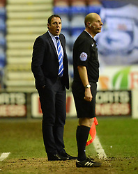 Wigan Athletic Manager, Malky Mackay protests to the Assistant Referee after he disallowed a goal  - Photo mandatory by-line: Richard Martin-Roberts/JMP - Mobile: 07966 386802 - 24/02/2015 - SPORT - Football - Wigan - DW Stadium - Wigan Athletic v Cardiff City - Sky Bet Championship