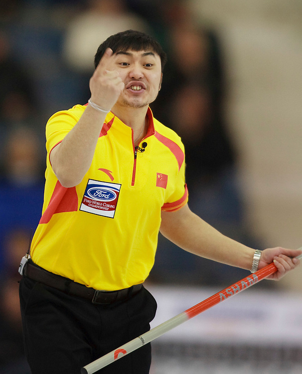 China's Skip Yansong Ji screams during the 10th end of their 5-4 loss to Canada at the World Curling Championships at the Brandt Centre in Regina, Saskatchewan, April 7, 2011.<br /> AFP PHOTO/Geoff Robins