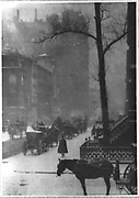 Horse-drawn carriages and snow in New York City, America, c1900.